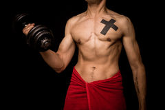 Young athletic shirtless man working out on black background Royalty Free Stock Image