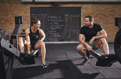 Young athletic sportspeople training on body builders Stock Image