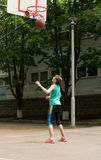 Young athletic teenage girl playing basketball Royalty Free Stock Photography