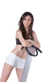 Young athletic woman advertise massage machine. Young athletic woman wear a black cotton belly top and white shorts advertise massage machine, isolated on white Stock Photo