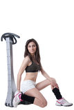 Young athletic woman advertise massage machine. Young athletic woman wear a black cotton belly top and white shorts advertise massage machine, isolated on white Stock Photos