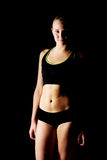 Young athletic woman in black sports underwear.  Royalty Free Stock Photography