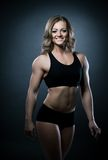 Young athletic woman body builder portrait Stock Photos