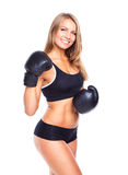 Young athletic woman in boxing gloves Royalty Free Stock Photo