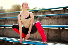 Young athletic woman dancer doing exercises in old city stadium. Young athletic woman dancer doing exercises in the old city stadium Royalty Free Stock Image