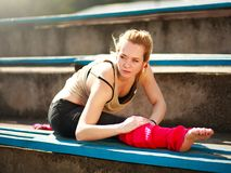 Young athletic woman dancer doing exercises in old city stadium. Young athletic woman dancer doing exercises in the old city stadium Royalty Free Stock Photography