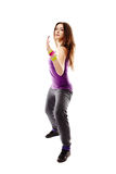 Young athletic woman doing dance moves Royalty Free Stock Image