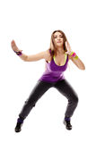 Young athletic woman doing dance moves Stock Images