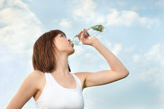 Young athletic woman drinking mineral water Stock Photos