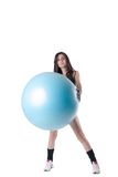 Young athletic woman exercised with a blue stability ball Royalty Free Stock Photography