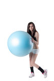 Young athletic woman exercised with a blue stability ball Stock Photo
