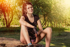 Young athletic woman. Has a rest after the sports training in the city park Stock Photo