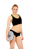 Young athletic woman holding balance board Royalty Free Stock Photography