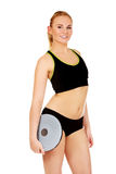 Young athletic woman holding balance board Royalty Free Stock Photos