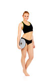 Young athletic woman holding balance board Stock Image