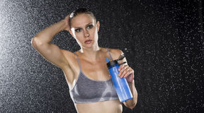 Young Athletic Woman Holding a Bottle of Water Royalty Free Stock Photography