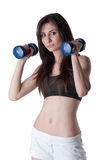 Young athletic woman holding a dumbbells Royalty Free Stock Photography