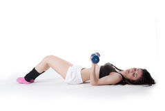 Young athletic woman holding a dumbbells Royalty Free Stock Images