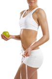 Young athletic woman holding a green apple Stock Photo