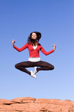 Young athletic woman jumping. Beautiful young athletic woman jumping high Stock Photography