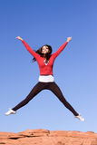Young athletic woman jumping Royalty Free Stock Image