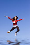 Young athletic woman jumping Stock Photo