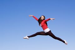 Young athletic woman jumping. Beautiful young athletic woman jumping high Stock Image
