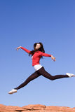 Young athletic woman jumping. Beautiful young athletic woman jumping high Royalty Free Stock Photography