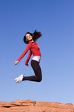 Young athletic woman jumping Stock Photography