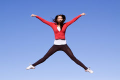 Young athletic woman jumping. Beautiful young athletic woman jumping high Royalty Free Stock Images