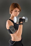 Young athletic woman lifting weights Stock Photography