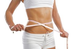 Young athletic woman measuring waist Royalty Free Stock Photos