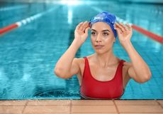 Young athletic woman in pool. Young athletic woman in swimming pool royalty free stock photos