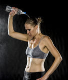 Young Athletic Woman Pouring Water Over Head royalty free stock images