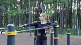 Young athletic woman resting after workout outdoors. Young athletic woman resting after workout outdoors stock footage