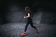 Young athletic woman running outdoor Royalty Free Stock Photography