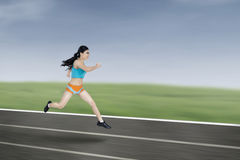 Young athletic woman running Stock Photo
