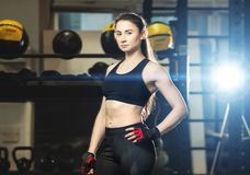 Young athletic woman in sport outfit. Posing in the gym royalty free stock photo