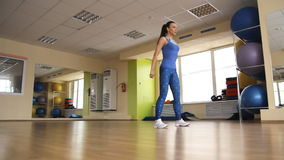 Young athletic woman trains in gym stock footage