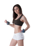 Young athletic woman wearing a wrist weights Stock Photo