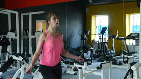 Young athletic woman working on fitness in gym with jump rope and healthy routine stock video footage