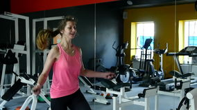 Young athletic woman working on fitness in gym with jump rope and healthy routine.  stock video