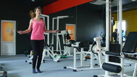 Young athletic woman working on fitness in gym with jump rope and healthy routine stock footage