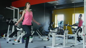 Young athletic woman working on fitness in gym with jump rope and healthy routine stock video