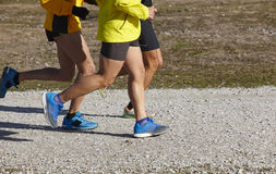 Young athletics runners on a race. Outdoor circuit Royalty Free Stock Photo