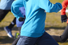 Young athletics runners on a race. Outdoor circuit Stock Images