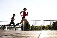 Free Young Athtletes In The City Running At The River. Royalty Free Stock Image - 112464186