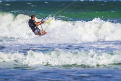 Young atletic man riding kite surf on a sea Royalty Free Stock Photos