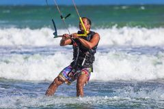 Young atletic man riding kite surf on a sea Royalty Free Stock Photography
