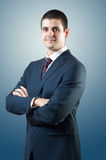 Smiling businessman. Young atractive male, standing and posing like politician or businessman. Looking at camera and smiling Royalty Free Stock Images